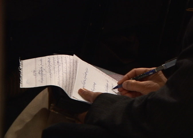 Kabul: Constitutions, video still of a delegate writing (interactive 3-channel video installation rt 1:30:00) 2005